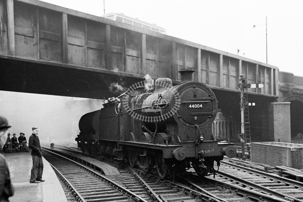 Ex MR 4F 0-6-0 No.44004 attracts the attention of the local spotters as she arrives with a single tank at Birmingham New Street - H Cartwright - CW11532