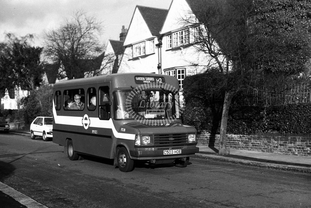 London Transport Ford Transit FS28 C503HOE  on route H2  at Hampstead Garden Suburb  in 1980s - JGS Smith