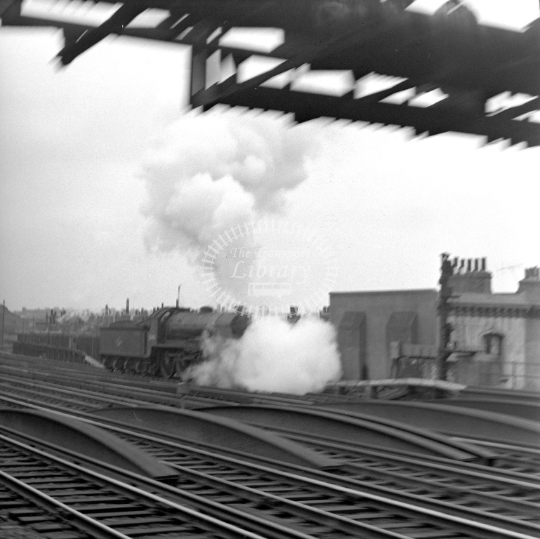 British Railways 30451 N15 (RF distant) L/E on Nine Elms sidings prior to going up to Waterloo 28/4/62 (front of loco shrouded in steam) - James Harrold