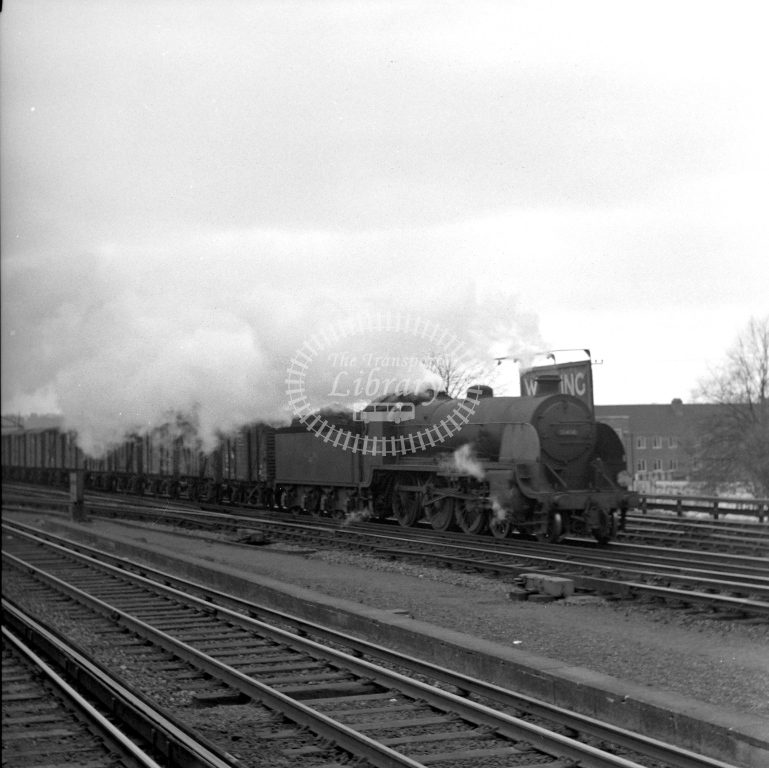 British Railways 30498 S15 (RF) tn vans passing Woking 28/4/62 (not sharp) - James Harrold