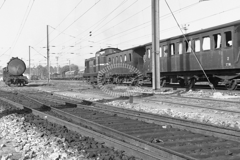 CP Bo-Bo diesel on 4 wheel stock passing Contumil Yard, Porto 1969 (Frank Saunders) - Lens of Sutton Association Portugal Collection
