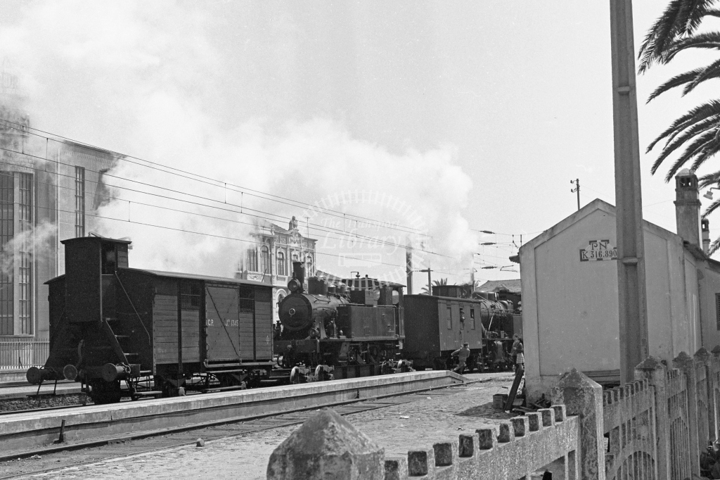 CP E101 2-6-0T on transporter wagon with CP 1345 caboose van at Espinho Station, Porto 1969 (Frank Saunders) - Lens of Sutton Association Portugal Collection