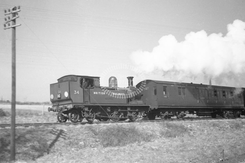 BR W34 Newport class O2  runing bunker first with passenger service at Smallbrook Junction 9/4/49; loco in malachite lettered 'British Railways'; R3/4 rear view.-Lens of Sutton Association Isle of Wight (IOW) PM Alexander collection