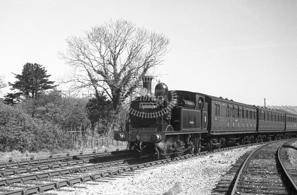 BR W21 Sandown class O2; arriving with passenger service at Sandown 9-4-49; loco in freshly painted BR lined black without a crest; L 3/4 front view.-Lens of Sutton Association Isle of Wight (IOW) PM Alexander collection