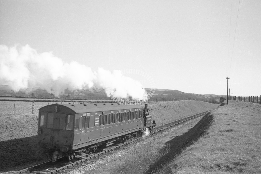 BR W13 Carisbrooke ex LBSC class A1X with push pull coach S6987 departing Merston for Ventnor West  9/4/49; view of train going away from camera showing S6987-Lens of Sutton Association Isle of Wight (IOW) PM Alexander collection