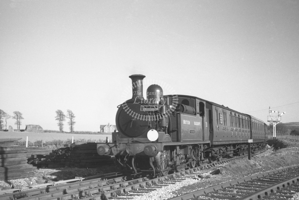 BR W30 Shorwell class O2  arriving with passenger service from Sandown at Merstone 9/4/49; loco in malachite lettered 'British Railways'; L3/4 front view.-Lens of Sutton Association Isle of Wight (IOW) PM Alexander collection