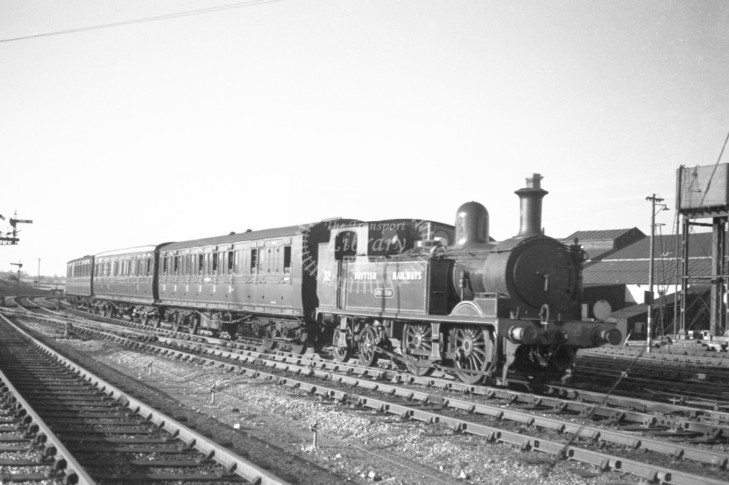 BR W32 Bonchurch class O2  arriving with passenger service from Cowes at Newport 9/4/49; loco in malachite lettered 'British Railways'; R3/4 front view.-Lens of Sutton Association Isle of Wight (IOW) PM Alexander collection