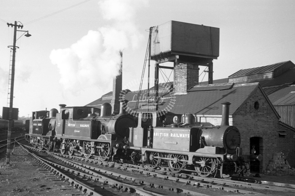 BR W8 Freshwater A1X in black, lettered 'British Railways' at Newport MPD 9/4/49 coupled to W27 Merstone class O2 in malachite lettered 'British Railways' and W2 E1 in black also lettered 'British Railways'; all R3/4 front view.-Lens of Sutton Association