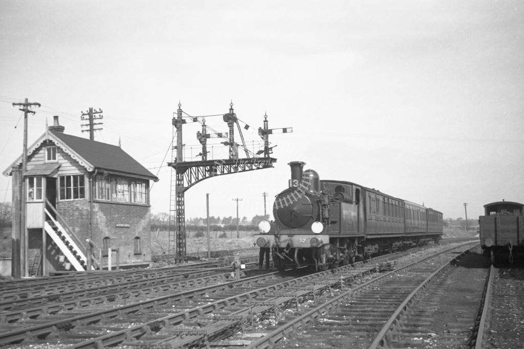 BR W32 Bonchurch class O2  arriving with passenger service from Cowes at Newport 10/4/49; loco in malachite lettered 'British Railways'; L3/4 front view.-Lens of Sutton Association Isle of Wight (IOW) PM Alexander collection