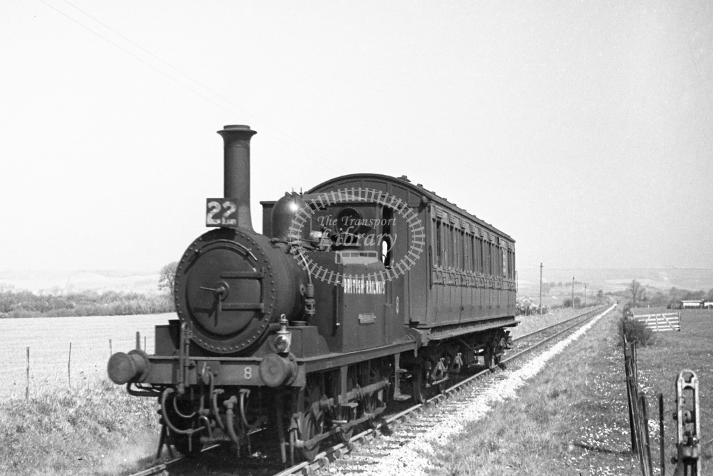 BR W8 Freshwater A1X in black, lettered 'British Railways' arriving at Godshill with single coach Ventnor West to Merstone service 16/4/49; L3/4 front view.-Lens of Sutton Association Isle of Wight (IOW) PM Alexander collection