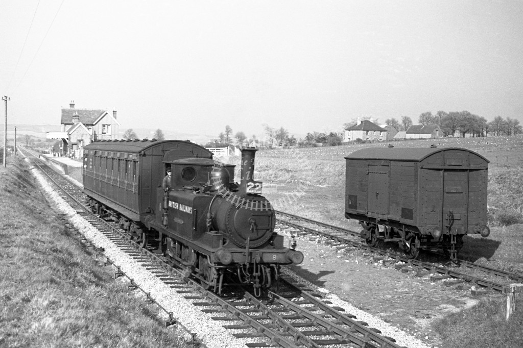BR W8 Freshwater A1X in black, lettered 'British Railways' leaving Godshill with single coach Ventnor West to Merstone service 16/4/49; R3/4 front view. Ex LBSC vacuum braked goods van in background.-Lens of Sutton Association Isle of Wight (IOW) PM Alexa