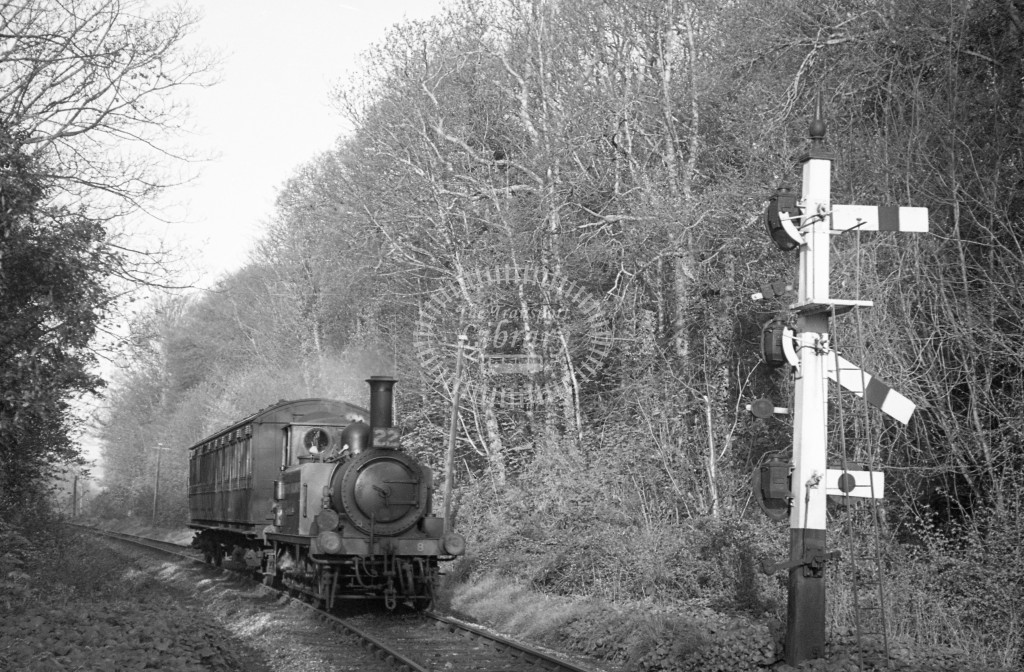 BR W8 Freshwater A1X in black, lettered 'British Railways' approaching Ventnor West with single coach service from Merstone  18/4/49; R3/4 front view. -Lens of Sutton Association Isle of Wight (IOW) PM Alexander collection