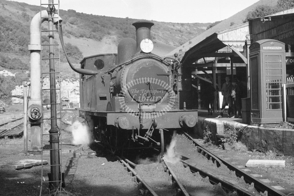 BR W28 Ashey class O2 being watered at  Ventnor circa 1960s; lined black with later crest, R3/4 front view.-Lens of Sutton Association Isle of Wight (IOW) PM Alexander collection