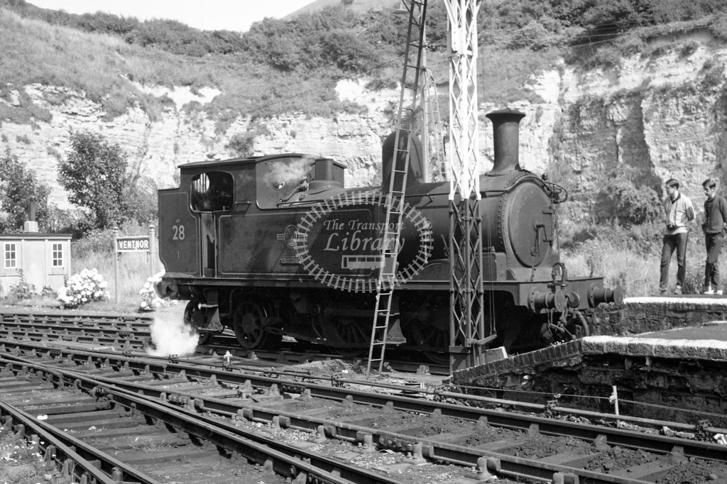 BR W28 Ashey class O2 at end of platform at Ventnor moving onto train circa 1960s; lined black with later crest, R3/4 front view.-Lens of Sutton Association Isle of Wight (IOW) PM Alexander collection