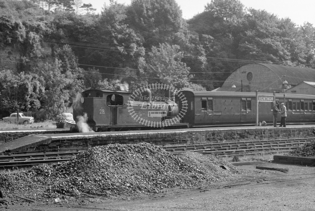 BR W28 Ashey class O2 at end of platform at Ventnor awaiting departure with passenger service circa 1960s; view across goods yard; lined black with later crest, R3/4 front view.-Lens of Sutton Association Isle of Wight (IOW) PM Alexander collection