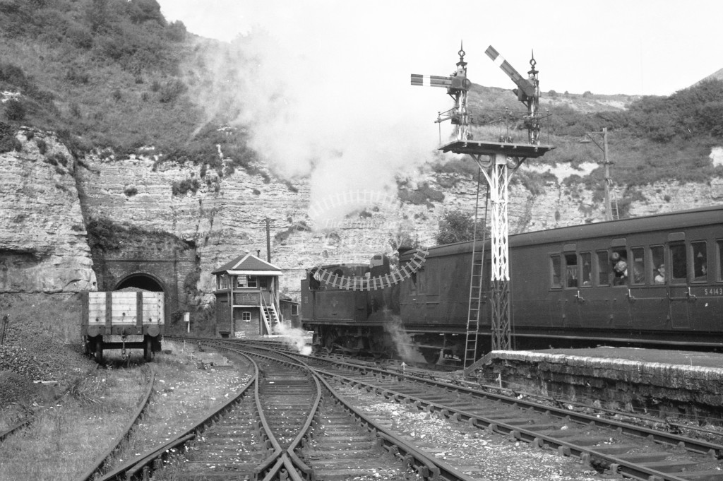 BR W28 Ashey class O2 departing bunker first with passenger service from Ventnor circa 1960s; lined black with later crest, R3/4 front view.-Lens of Sutton Association Isle of Wight (IOW) PM Alexander collection