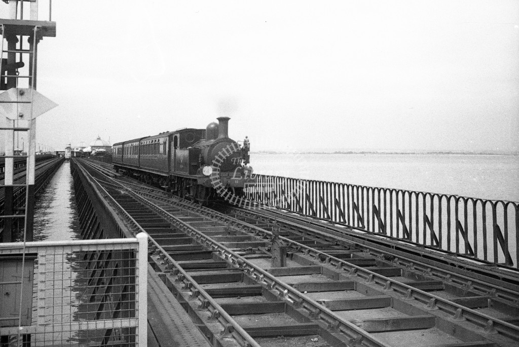 BR W33 Bembridge class O2 on down passenger service on pier approaching Ryde Esplanade; 12/6/64-Lens of Sutton Association Isle of Wight (IOW) WJ Probert collection