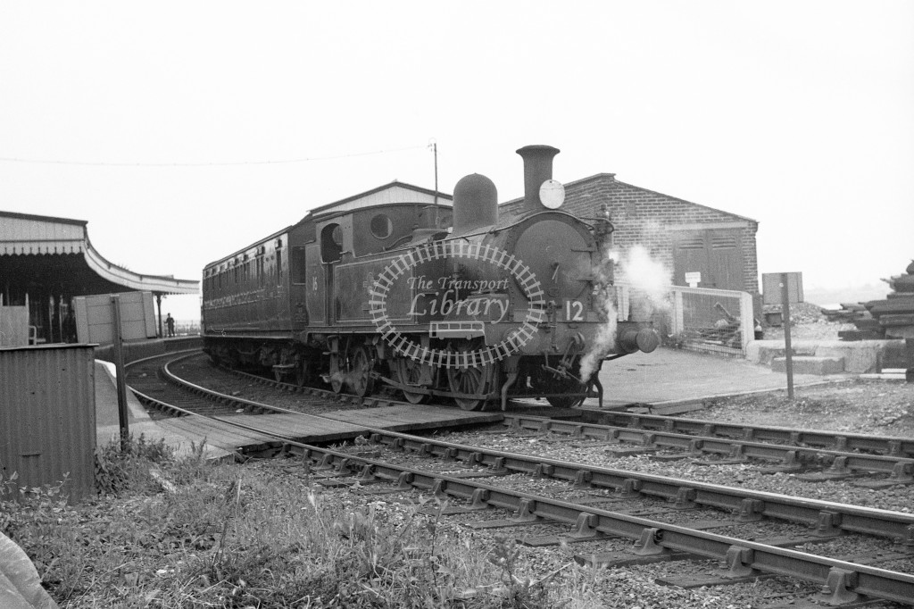 BR W16 Ventnorclass O2 on down passenger service departing from Ryde Esplanade; 12/6/64-Lens of Sutton Association Isle of Wight (IOW) WJ Probert collection