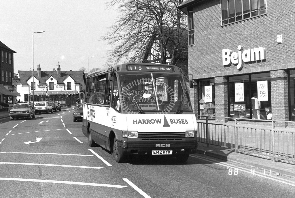 Harrow Buses MCW Metrorider MR42 E142KYW  at Harrow Weald , High Street  in 1987 on route  H15  - Russell Fell